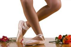 Reverence Ballet Workout. Dress Rehearsal. Caught movements of ballet workout; dress rehearsal; reverence ; focus on working leg Stock Photos