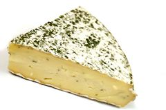 Reverend Brie. A wedge of herb-coated Reverend Brie Stock Photos