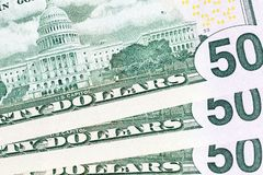 Reverse of dollars. The reverse of the folded fan of American dollars worth fifty, close-up of cash paper banknotes with American symbols royalty free stock photo