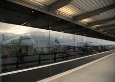 Reverse Jets mirrored in a window at the terminal Royalty Free Stock Photo