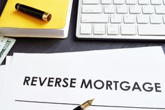 Reverse mortgage agreement and pen. stock image
