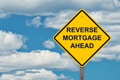 Reverse Mortgage Ahead Caution Sign royalty free stock photos