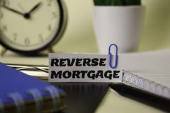Reverse Mortgage on the paper isolated on it desk. Business and inspiration concept stock photography