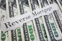 Reverse mortgage. Paper message on assorted cash Stock Image