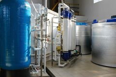 Reverse osmosis system - installation of industrial membrane devices. To the purification of drinking water: pumps, pipelines, tanks, etc royalty free stock photos