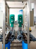Reverse osmosis system - installation of industrial membrane devices. To the purification of drinking water: pumps, pipelines, tanks, etc royalty free stock image