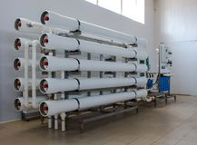Reverse osmosis system - installation of industrial membrane devices. To the purification of drinking water: pumps, pipelines, tanks, etc stock photo