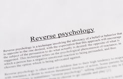 Reverse psychology - education or business concept Stock Image