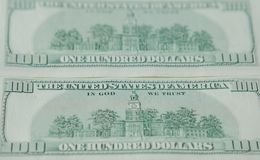The reverse side of American dollars. Background of dollar bills.  stock photography