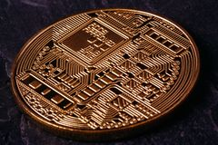 The reverse side of the crypto currency. The reverse side of the coin Close-up of the Bitcoin crypto currency royalty free stock photo
