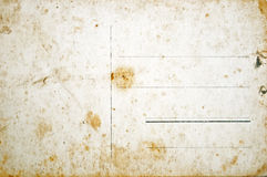Reverse side of empty grunge postcard Stock Photos