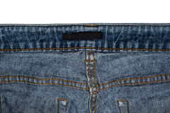 The reverse side of jeans with place for label  on a white background. The reverse side of jeans with place for label in high resolution on a white background Royalty Free Stock Photo