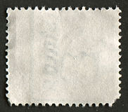 Reverse side of a postage stamp. Royalty Free Stock Images
