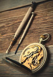 Reverse side of the vintage pocket watch and a screwdriver Stock Images