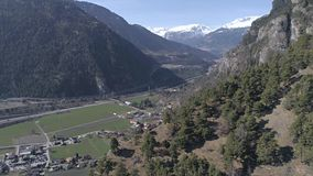 Reverse valley view aerial 4k. Aerial footage of a valley with mountains in the background. Shot in Switzerland in 4k quality stock video
