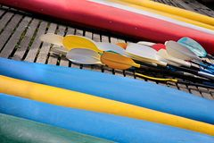 Reversed colorful kayaks and rowing on the shore Stock Images