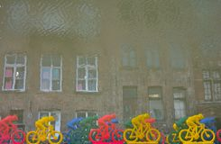 Reversed image concept: Plastic Cyclists on a river Royalty Free Stock Image