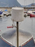 Reversed plastic bucket over a turned boat in harbor. Stock Images