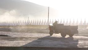 Reversing tractor in the morning sun stock footage