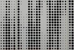 Revestimento cinzento do metal com furos circulares Imagens de Stock Royalty Free
