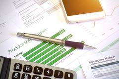 Account data and calculate. Review accounting data and calculate production income Royalty Free Stock Photography