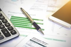 Account data and calculate. Review accounting data and calculate production income Royalty Free Stock Photo