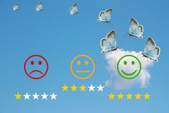 Review classification with happy and angry faces on blue sky background and stars.  Royalty Free Stock Image