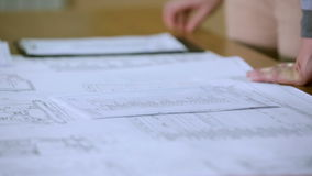 Review of documents and handshake closeup stock footage