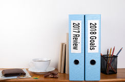 2017 review and 2018 goals. Two binders on desk in the office. Business background Stock Photo
