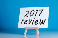 2017 review - poster with an inscription on a blue background. Time to summarize and plan goals for the next year. Business background Royalty Free Stock Photos