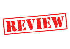 REVIEW. Red Rubber Stamp over a white background Royalty Free Stock Photo