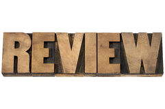 Review typography in wood type. Review word typography - isolated text in vintage letterpress wood type printing blocks Royalty Free Stock Photos