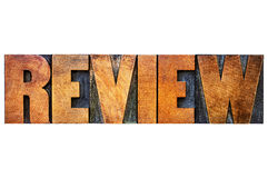 Review word abstract in letterpress wood type Royalty Free Stock Photo