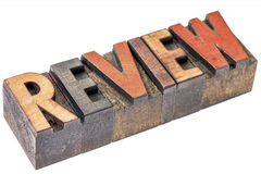 Review word in vintage letterpress wood type Stock Image
