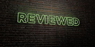 REVIEWED -Realistic Neon Sign on Brick Wall background - 3D rendered royalty free stock image. Can be used for online banner ads and direct mailers Stock Image