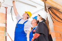 Reviewer or lawyer check building site for  defect Stock Photo