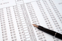 Reviewing the accounts. Reviewing the accounts on a printed spreadsheet royalty free stock images