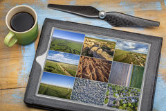 Reviewing aerial pictures on digital tablet Stock Photos