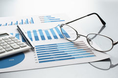 Reviewing business report. Graphs and charts. Stock Photo