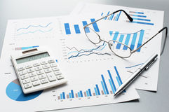 Reviewing business reports. Graphs and charts. Royalty Free Stock Images