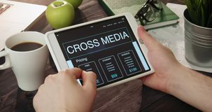 Reviewing cross media info using digital tablet stock video