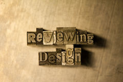 Reviewing design - Metal letterpress lettering sign Royalty Free Stock Photos