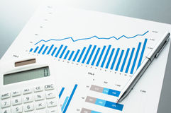Reviewing financial report. Graphs and charts. Stock Images