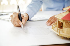 Reviewing floor plan Royalty Free Stock Photography