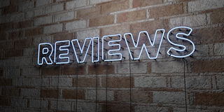 REVIEWS - Glowing Neon Sign on stonework wall - 3D rendered royalty free stock illustration Stock Photos