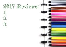 2017 Reviews text on white sketchbook with color pen, top view Stock Photos