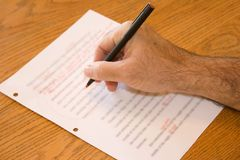 Revise Hand. A hand making editing marks on a document Stock Photos