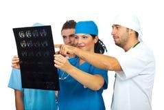 Revisión MRI de cuatro doctores Imagen de archivo libre de regalías