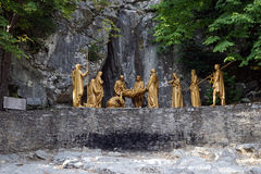 Revival. LOURDES, FRANCE - CIRCA JULY 2015 Sculptures with Crist and romans near cave after revival royalty free stock images