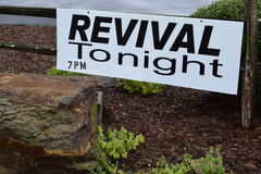 Revival Tonight 7PM Sign. Revival sign on a fence royalty free stock image